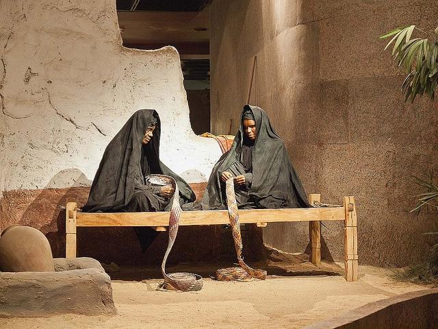 A Scene of Two Women Making Basket