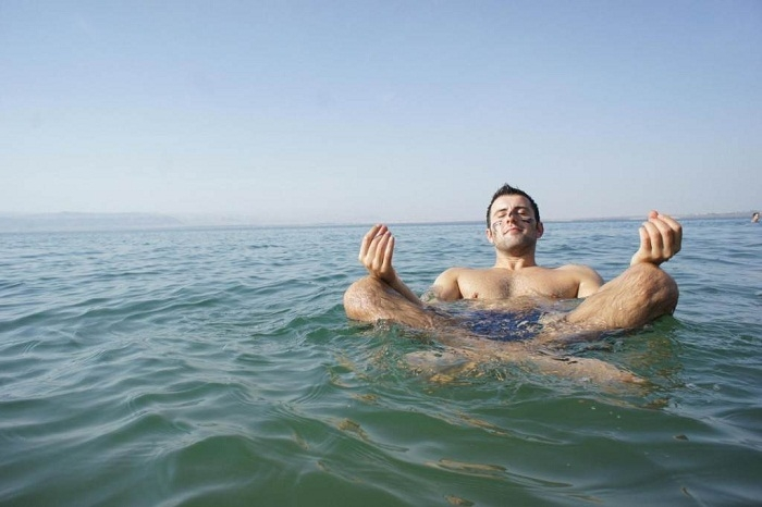 Floating on the Dead Sea Water