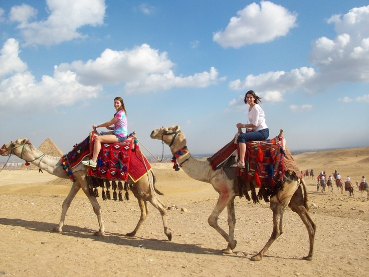 Camel riding around Pyramids