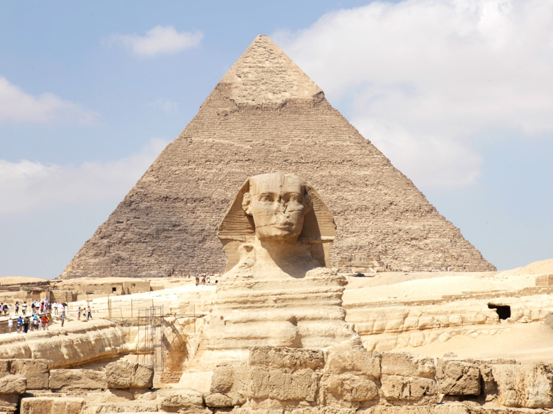 The Great Sphinx with background of the Pyramids