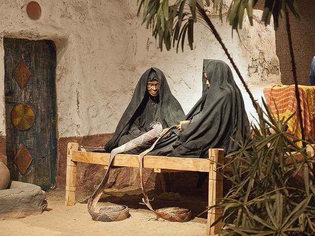 Scene of Two Women Making Basket