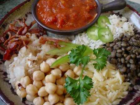 A Plate of Koshari with Humous and Sause
