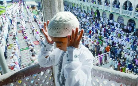 Omani Boy Pray during Eid Al Fitr