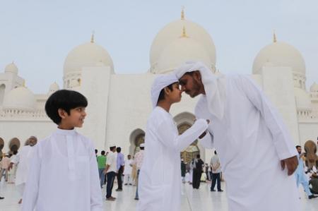 Omanis pray in The Sultan Qaboos Mosque