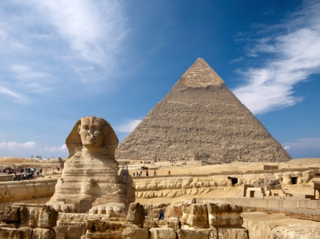Sphinx with background of Giza Pyramid