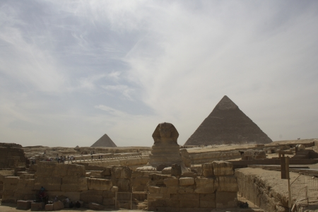Sphinx with background of Giza Pyramids